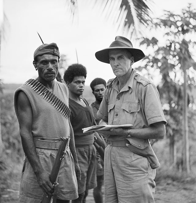 Sergeant-Major Katue of the Papuan Infantry Battalion and Captain Thomas Grahamslaw of the Australian New Guinea Administrative Unit (ANGAU), with members of the Royal Papuan Constabulary, 1942